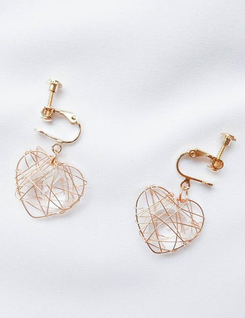Lrc anting jepit  Fashion Gold Color heart Shape Decorated Earrings
