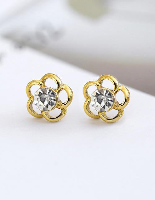 LRC Anting Tusuk Fashion Gold Color Flower Shape Decorated Hollow Out Earrings