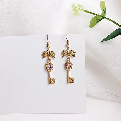 LRC Anting Gantung Fashion Gold Color+purple Heart Shape Decorated Earrings